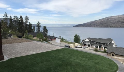 turf installation in a backyard with a view of Kelowna