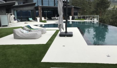 landscaped backyard with turf installation